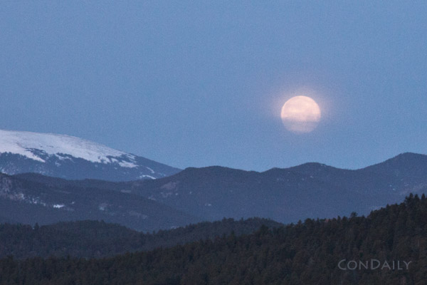 March 20 moon rising over the mountains